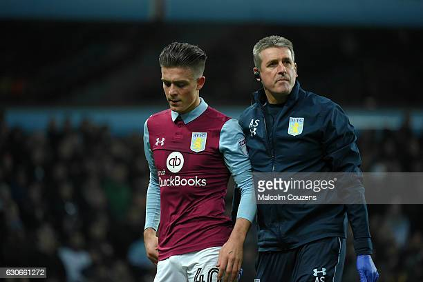 Jack Grealish of Aston Villa leaves the pitch with an injury during the Sky Bet Championship match between Aston Villa and Leeds United at Villa Park...