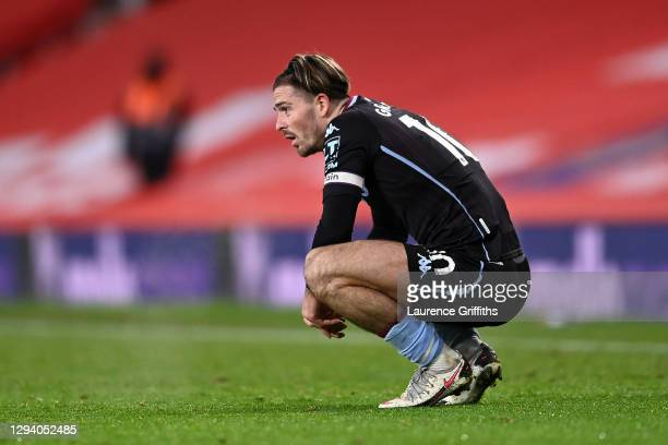 Jack Grealish of Aston Villa looks dejected following the Premier League match between Manchester United and Aston Villa at Old Trafford on January...