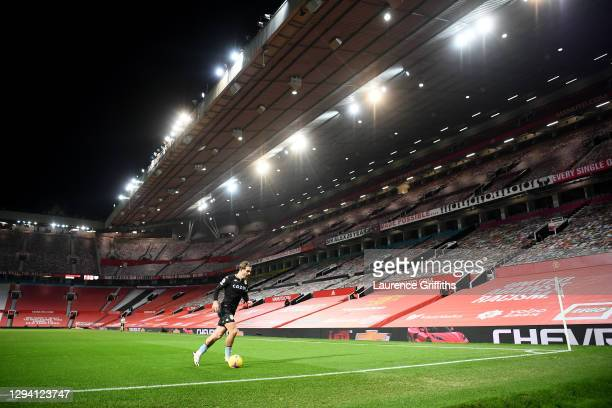 Jack Grealish of Aston Villa prepares to take a corner kick in from of the empty Sir Alex Ferguson stand during the Premier League match between...