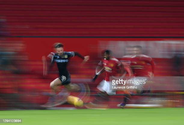 Jack Grealish of Aston Villa runs with the ball during the Premier League match between Manchester United and Aston Villa at Old Trafford on January...