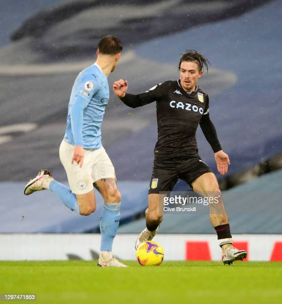 Jack Grealish of Aston Villa runs with the ball during the Premier League match between Manchester City and Aston Villa at Etihad Stadium on January...
