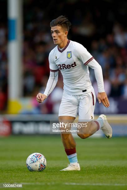 Jack Grealish of Aston Villa runs with the ball during the preseason friendly between Walsall and Aston Villa at the Banks' Stadium on July 17 2018...
