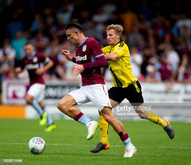 Jack Grealish of Aston Villa scores for Aston Villa during the PreSeason Friendly match between Burton Albion and Aston Villa at the Pirelli Stadium...