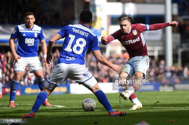 Jack Grealish of Aston Villa scores his sides first goal during the Sky Bet Championship match between Birmingham City v Aston Villa at St Andrew's...