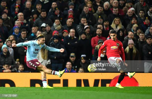 Jack Grealish of Aston Villa scores his sides first goal during the Premier League match between Manchester United and Aston Villa at Old Trafford on...