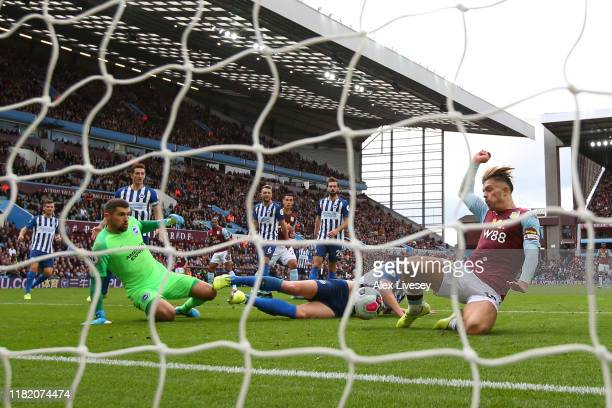 Jack Grealish of Aston Villa scores his team's first goal during the Premier League match between Aston Villa and Brighton Hove Albion at Villa Park...