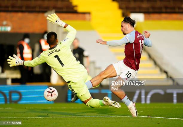 Jack Grealish of Aston Villa scores his team's first goal during the Premier League match between Fulham and Aston Villa at Craven Cottage on...