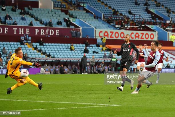 Jack Grealish of Aston Villa scores his team's seventh goal past Adrian of Liverpool during the Premier League match between Aston Villa and...