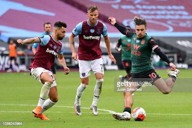 Jack Grealish of Aston Villa scores the first goal during the Premier League match between West Ham United and Aston Villa at London Stadium on July...
