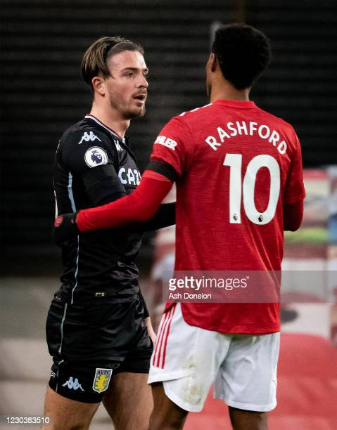 Jack Grealish of Aston Villa shakes hands with Marcus Rashford of Manchester United at the end of the Premier League match between Manchester United...