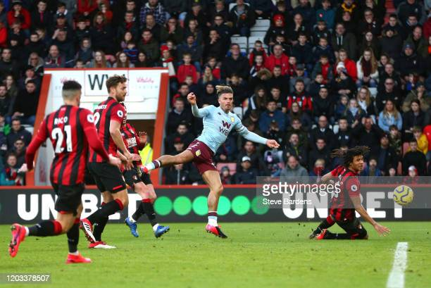 Jack Grealish of Aston Villa shoots as Nathan Ake of AFC Bournemouth attempts to block during the Premier League match between AFC Bournemouth and...