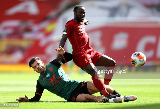 Jack Grealish of Aston Villa tackles Naby Keita of Liverpool during the Premier League match between Liverpool FC and Aston Villa at Anfield on July...