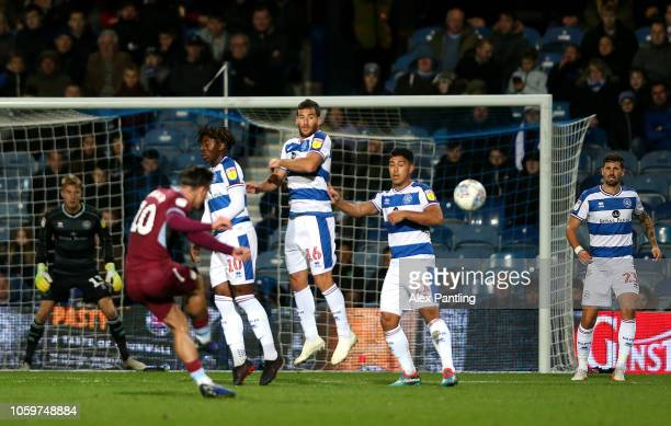 Jack Grealish of Aston Villa takes a freekick and strikes the post during the Sky Bet Championship match between Queens Park Rangers and Aston Villa...