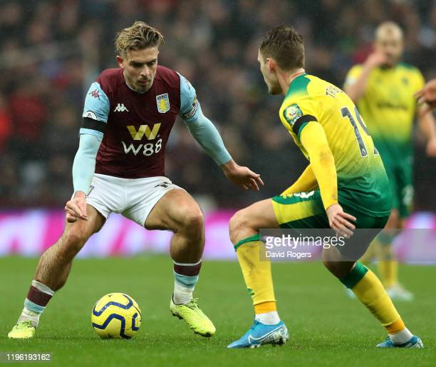 Jack Grealish of Aston Villa takes on Tom Trybull during the Premier League match between Aston Villa and Norwich City at Villa Park on December 26,...