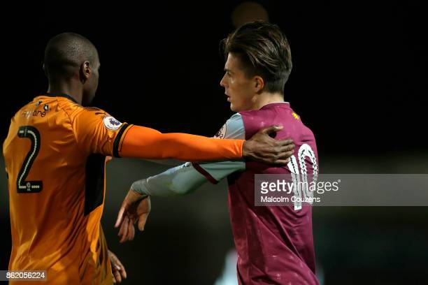 Jack Grealish of Aston Villa tangles with Prince Oniangue of Wolverhampton Wanderers during the Premier League 2 game between Wolverhampton Wanderers...