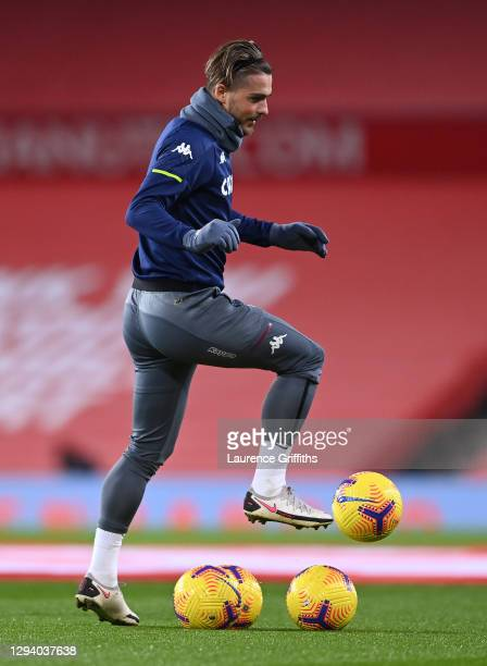 Jack Grealish of Aston Villa warms up prior to the Premier League match between Manchester United and Aston Villa at Old Trafford on January 01, 2021...