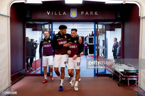 Jack Grealish of Aston Villa with team mate Tyrone Mings before the Sky Bet Championship match between Aston Villa and Derby County at Villa Park on...