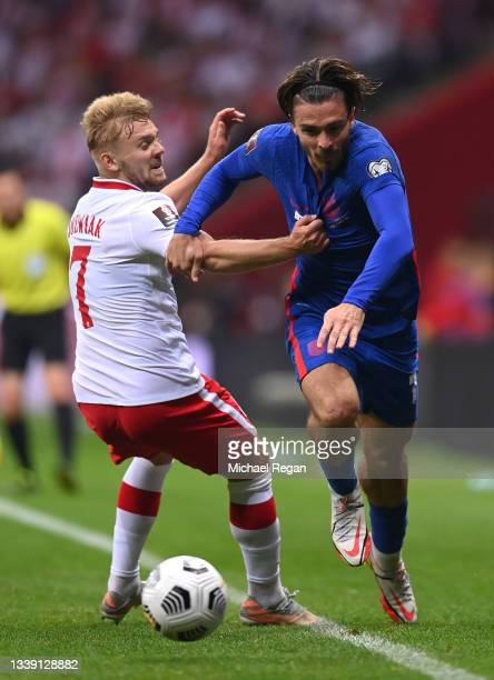 Jack Grealish of England is challenged by Kamil Jozwiak of Poland during the 2022 FIFA World Cup Qualifier match between Poland and England at...