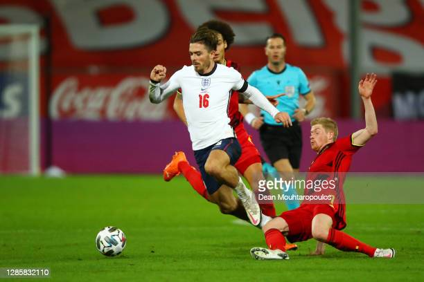 Jack Grealish of England is tackled by Kevin De Bruyne of Belgium during the UEFA Nations League group stage match between Belgium and England at...