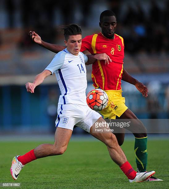 Jack Grealish of England is tackled by Salimou Toure of Guinea during the Toulon Tournament match between England and Guinea at Stade De Lattre on...