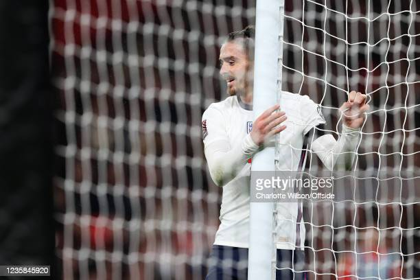 Jack Grealish of England looks dejected as he holds onto the net during the 2022 FIFA World Cup Qualifier match between England and Hungary at...