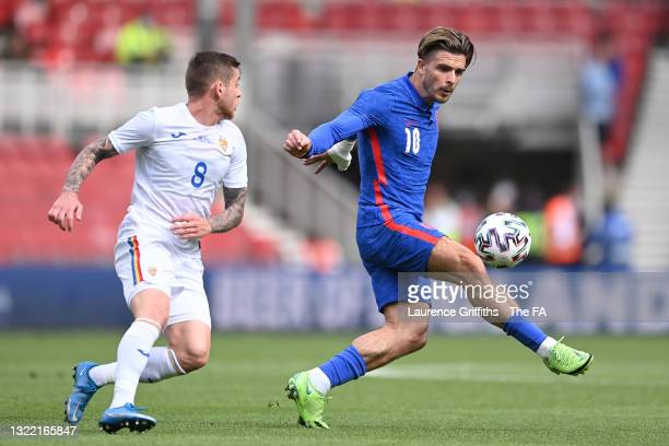Jack Grealish of England on the ball whilst under pressure from Alexandru Cicaldau of Romania during the international friendly match between England...