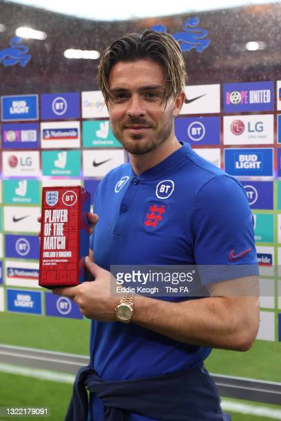 Jack Grealish of England poses for a photograph with the Player of the Match award after the international friendly match between England and Romania...