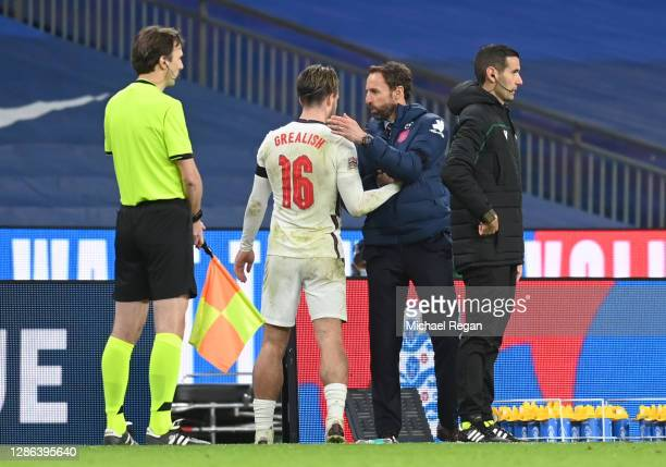 Jack Grealish of England speaks to Gareth Southgate, Manager of England after being subbed during the UEFA Nations League group stage match between...