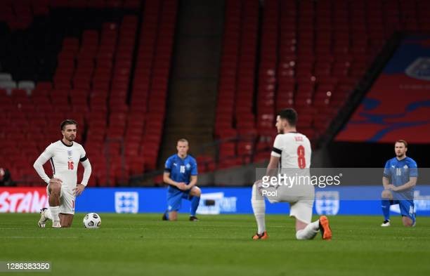 Jack Grealish of England takes a knee in support of the Black Lives Matter movement prior to the UEFA Nations League group stage match between...