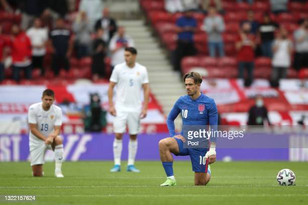 Jack Grealish of England takes a knee in support of the Black Lives Matter movement prior to the international friendly match between England and...