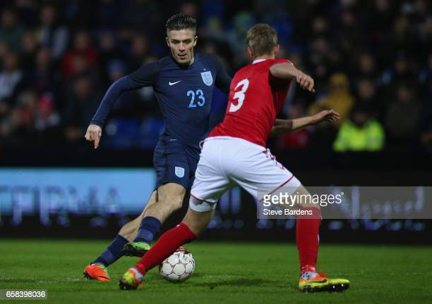 Jack Grealish of England takes on Andreas Maxso of Denmark during the U21 international friendly match between Denmark and England at BioNutria Park...
