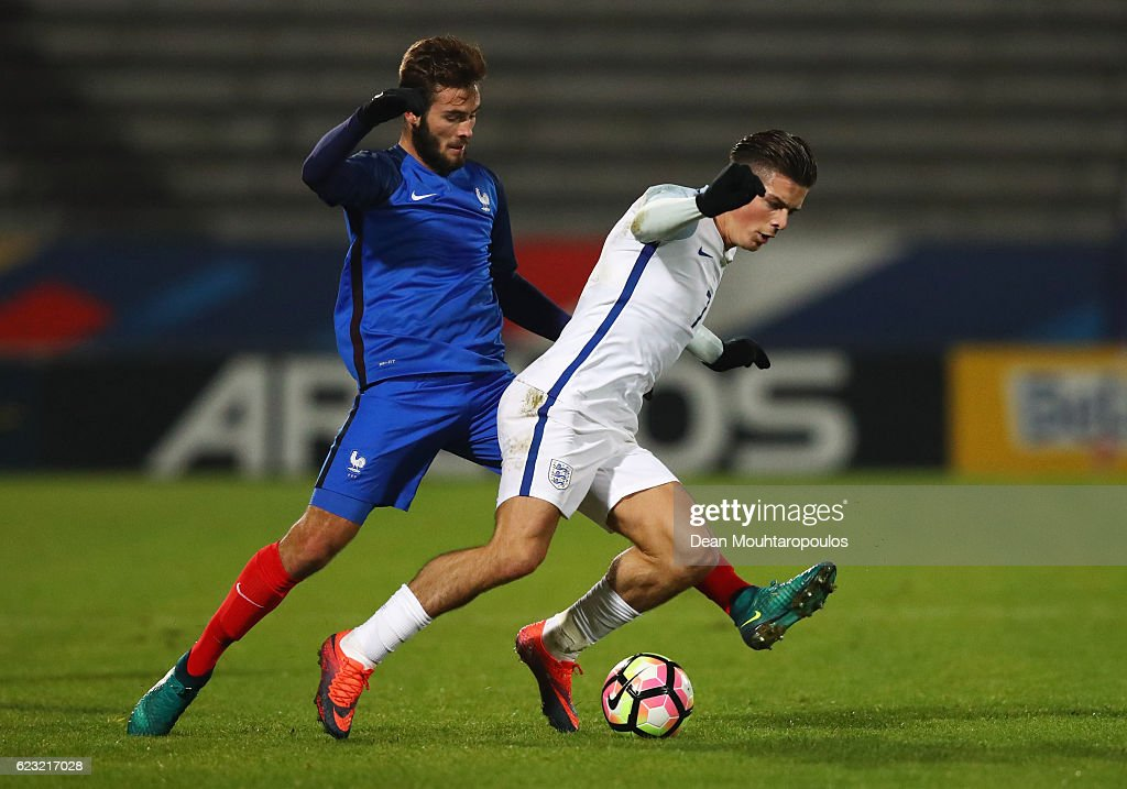 Jack Grealish of England U21 is challenged by Lucas Tousart of France U21 during the U21 international friendly match between France and England at Stade Robert Bobin on November 14, 2016 in Paris, France.