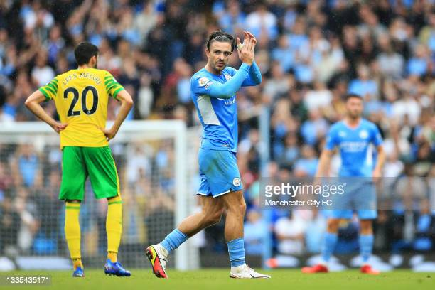 Jack Grealish of Manchester City applauds the fans as he leaves the pitch after being substituted during the Premier League match between Manchester...