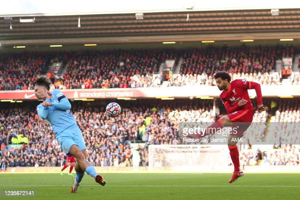 Jack Grealish of Manchester City blocks a shot by Mohamed Salah of Liverpool during the Premier League match between Liverpool and Manchester City at...