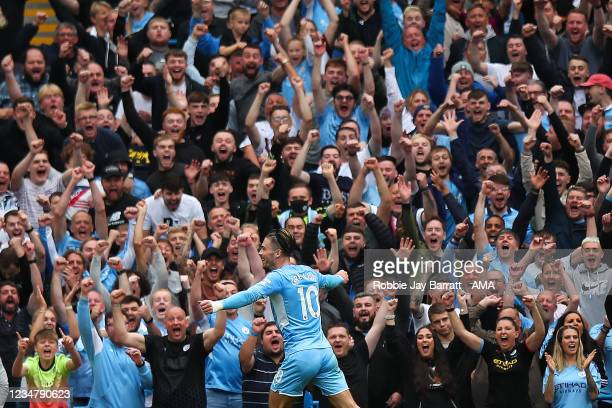 Jack Grealish of Manchester City celebrates after scoring a goal to make it2-0 during the Premier League match between Manchester City and Norwich...