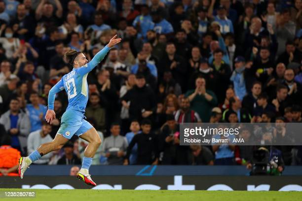Jack Grealish of Manchester City celebrates after scoring a goal to make it 4-2 during the UEFA Champions League group A match between Manchester...
