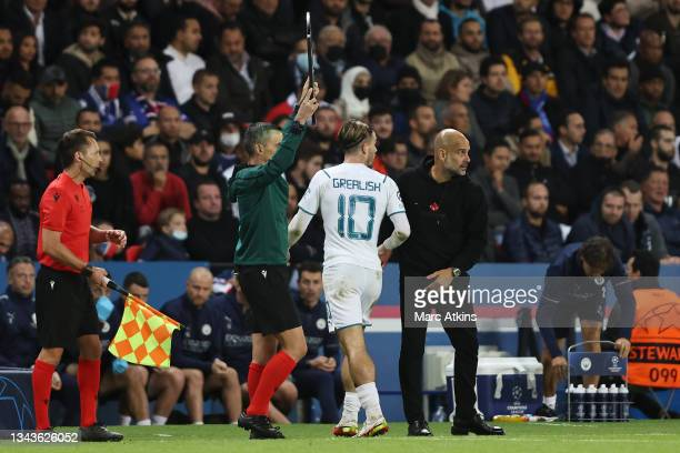 Jack Grealish of Manchester City is greeted by Pep Guardiola, Manager of Manchester City as he is substituted off during the UEFA Champions League...