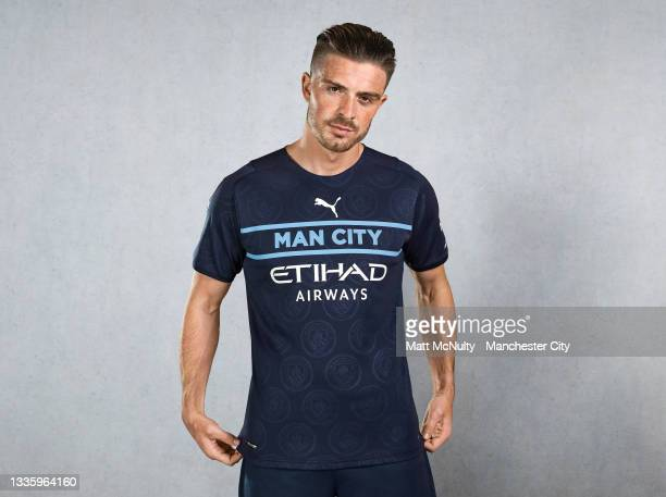 Jack Grealish of Manchester City poses wearing the 3rd kit at Etihad Stadium on August 09, 2021 in Manchester, England.