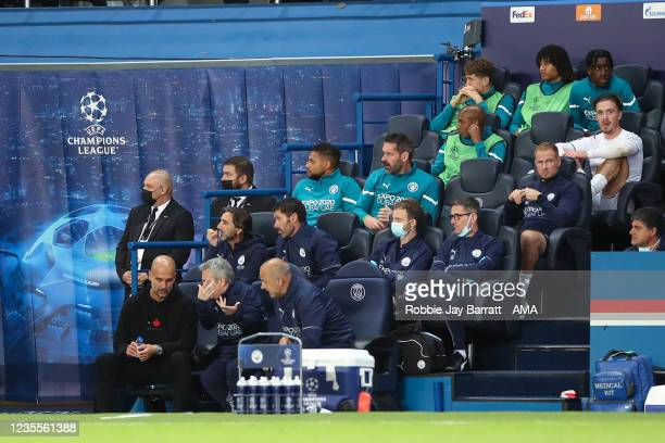 Jack Grealish of Manchester City sits on the bench after being substituted during the UEFA Champions League group A match between Paris Saint-Germain...
