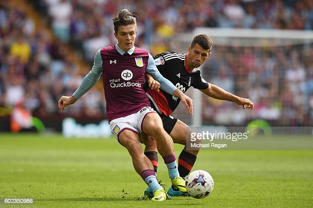 Jack Grealish of Villa in action with Eric Lichaj of Notts Forest during the Sky Bet Championship match between Aston Villa and Nottingham Forest at...