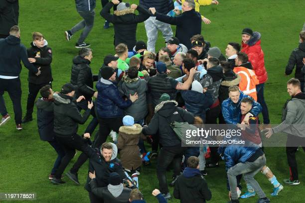 Jack Grealish of Villa is mobbed by Villa fans as they celebrate victory after the Carabao Cup Semi Final match between Aston Villa and Leicester...