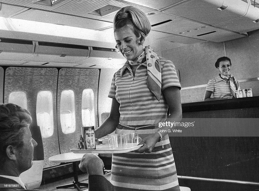 JUL 1971, JUL 17 1971; Jack Gregory Of Los Angeles Receives Drink In Polynesian Pub; Providing service aboard Continental Airlines' 747 is Maureen Guth, serving, and Joy Gazdik, bartender.; Lounges Replace Seats;