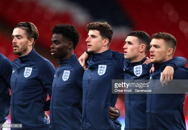 Jack Grelish Bukayo Saka Mason Mount Jack Grelish and Kieran Trippier of England sing the national anthem ahead of the UEFA Nations League group...