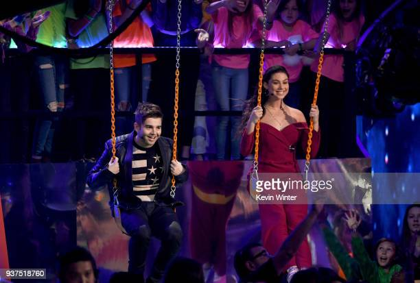 Jack Griffo and Kira Kosarin speak onstage at Nickelodeon's 2018 Kids' Choice Awards at The Forum on March 24 2018 in Inglewood California