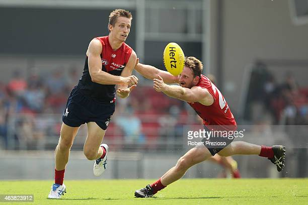 Jack Grimes handballs during the Melbourne Demons AFL IntraClub match at Casey Fields on February 19 2015 in Melbourne Australia