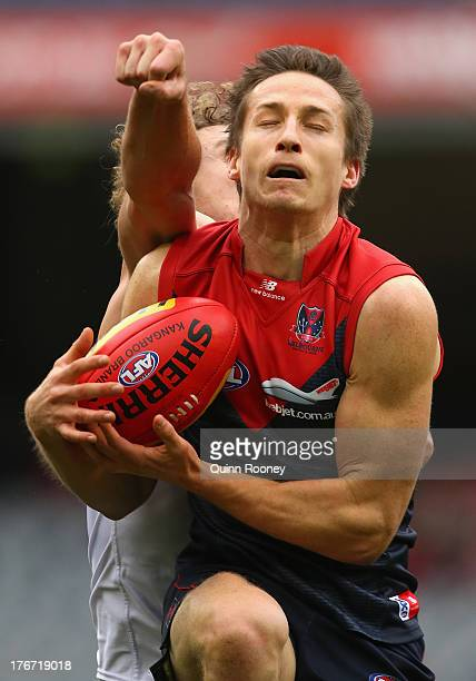 Jack Grimes of the Demons marks during the round 21 AFL match between the Melbourne Demons and the Fremantle Dockers at Melbourne Cricket Ground on...