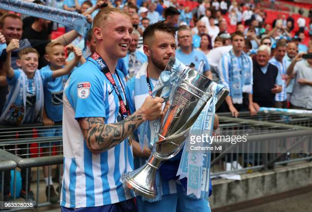 Jack Grimmer of Coventry City and Marc McNulty of Coventry City celebrate victory with the trophy after the Sky Bet League Two Play Off Final between...