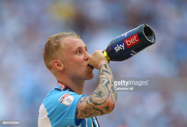 Jack Grimmer of Coventry City drinks from a champagne bottle after the Sky Bet League Two Play Off Final between Coventry City and Exeter City at...