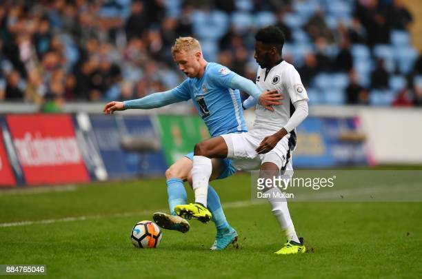 Jack Grimmer of Coventry City holds off Blair Turgott of Borehamwood during the The Emirates FA Cup Second Round match between Coventry City and...