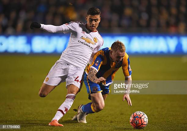 Jack Grimmer of Shrewsbury Town battles with Andreas Pereira of Manchester United during the Emirates FA Cup fifth round match between Shrewsbury...